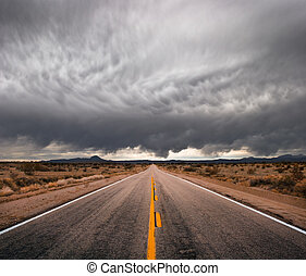 Stormy Road - An empty desert road with dark and foreboding...