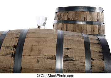 whiskey glass and barrels - Whiskey glass on a whiskey...