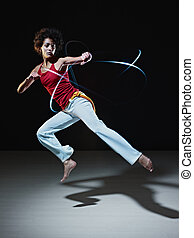 hispanic woman playing capoeira martial art - young adult...