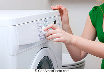 Woman washing clothes with machine - Woman only hands and...