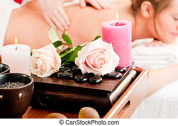Back massage in Spa - Spa - accessories in foreground, woman...