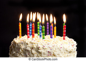 birthday cake and candles on black background - happy...