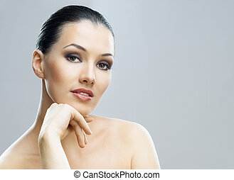 beauty portrait - a beauty girl on the grey background