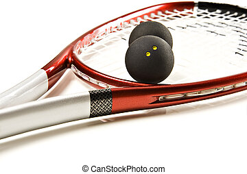 Squash racket and balls - Close up of a squash racket and...
