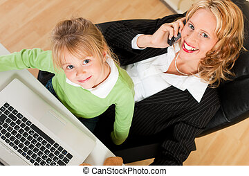 Businesswoman and mother is working in the internet - Family...