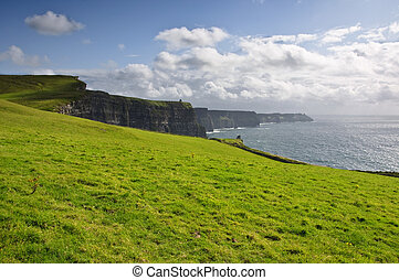 famous irish cliffs of moher in county clare, ireland -...