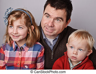 beautiful father with his son and daugther portrait - photo...