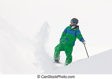 Skier dusting snow - Skier dusting some snow in the alps in...