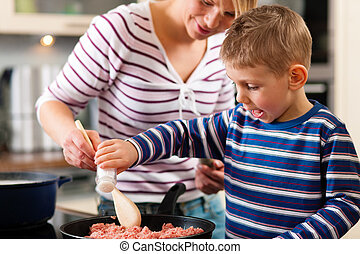 Family cooking in kitchen - Family cooking in their kitchen...