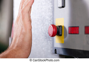 Emergency Man shutting machine of - Man is shutting off a...