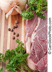 Raw meat - A piece of raw meat on a multilayer wooden...