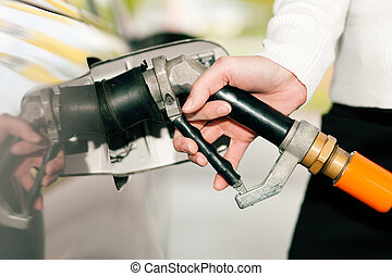 Woman refueling car with LPG gas - Woman - just hand to be...