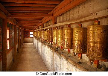 Prayer Wheels. Tibet - Golden Buddhist prayer wheels, Tibet