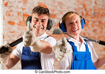 Friendly construction workers with thumps up