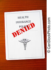 "a health insurance policy, with ""Denied"" stamp"