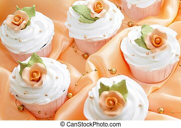 Wedding Cup Cakes on orange table top