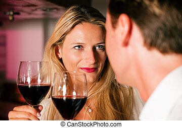 Casual Businesspeople flirting in hotel bar - Two casual...