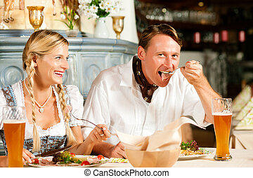Bavarian Couple in restaurant eating