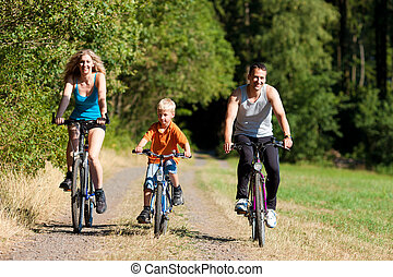 Family riding bicycles for sport - Family with child on...
