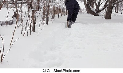 Man shoveling mass of snow