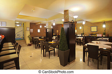 Restaurant Interior - Tables, chairs, brick wall and...