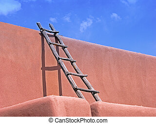 Southwest Ladder - Ladder and shadow on adobe building,...
