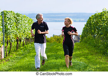 Senior couple jogging for sport - Mature or senior couple...