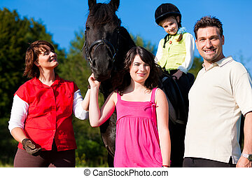 Family and children posing with horse - Family with children...