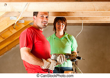 Couple in home improvement - DIY couple in home improvement...