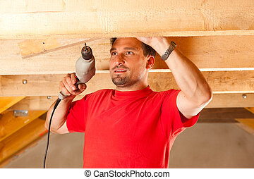 Construction worker with hand drill - Carpenter or...