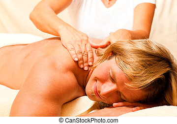 Man and Wellness with massage