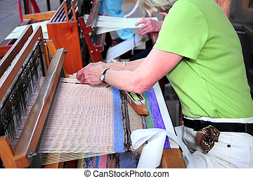 Hand weaver. - Female hand weaver working on a project.