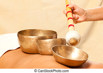 Woman and Wellness with singing bowls - Woman in wellness...