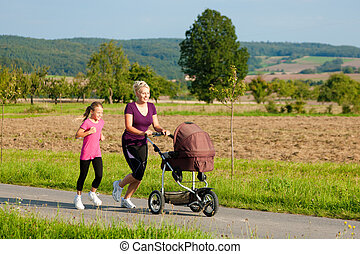 Family sport - jogging with baby stroller - Family sport -...