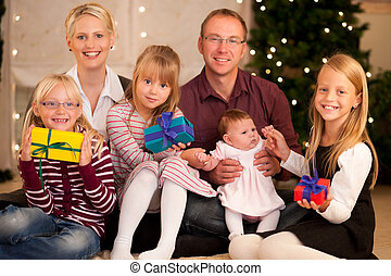Family with presents at Christmas