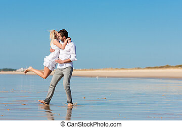 Couple on the beach running into glorious future - Couple on...