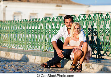 City tourism - couple in vacation on bridge - Couple having...