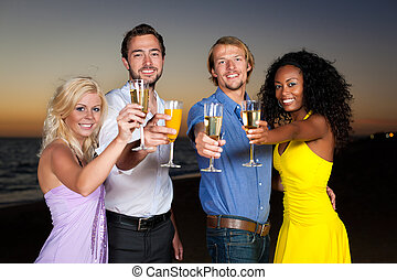 Party with champagne reception at the beach - People (two...