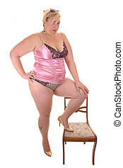 Big girl - An big overweight woman in pink lingerie...