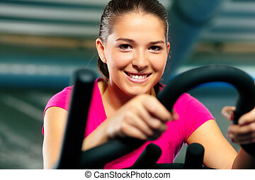 Indoor bycicle cycling in gym - Woman spinning in the gym,...