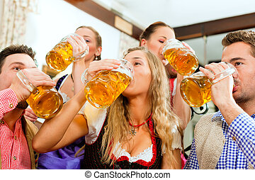 People drinking beer in Bavarian pub - Inn or pub in Bavaria...