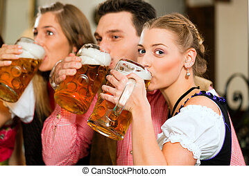 People drinking beer in Bavarian pub