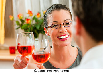Couple drinking rose wine - Young couple having romantic...