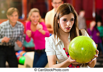 Friends bowling having fun