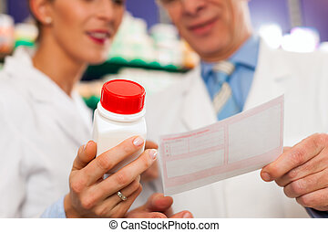 Two pharmacists in pharmacy consulting - Two pharmacists...