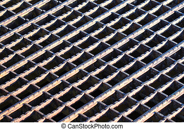 Rusty Grate Background - Background of a rusty steel grate