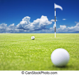 Golf course with balls - Golf ball on a putting green with...