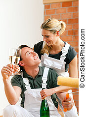Couple moving in new apartment renovating - Young couple...