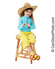 Little girl in straw hat sitting on wooden chair - The...