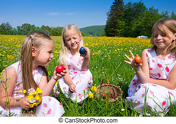 Children on Easter egg hunt with eggs - Children on an...